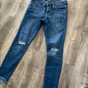 Distressed skinny jeans size 25